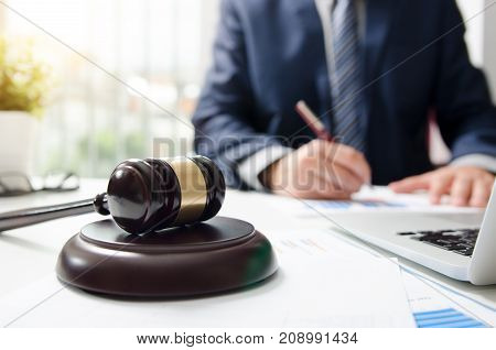 Wooden gavel on table. Attorney working in courtroom. law attorney court judge justice gavel legal legislation concept