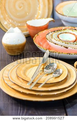 all kinds of tableware on wooden table closeup