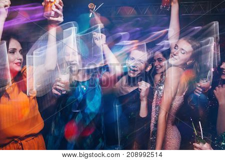 New Year dance party in motion. Happy friends company in night club, active Christmas celebration. Disco people in blurred colors, modern youth life, pickup concept