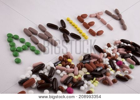 Hand Writing Text Caption Inspiration Medical Care Concept Written With Pills Drugs Capsule Word Anx