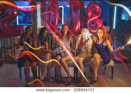 New 2018 Year. Happy girls company. Christmas celebration party, female friends in night club. Pleasant leisure time, friendship concept
