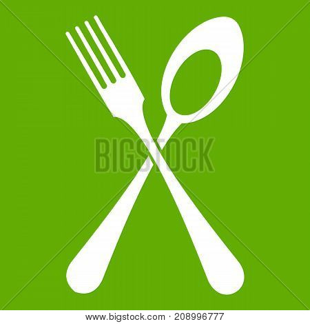 Spoon and fork icon white isolated on green background. Vector illustration