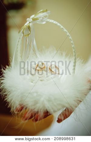 Beautiful white basket with bow for wedding rings