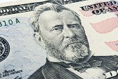 Ulysses S. Grant face on US fifty or 50 dollars bill macro united states money closeup. Heap of 50 hundred dollar bills on money background. poster