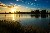 Autumn sunset on riverbank of Vah river in Piestany (Slovakia) poster