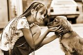 The little girl tenderly embraces the puppy. Soft focus poster