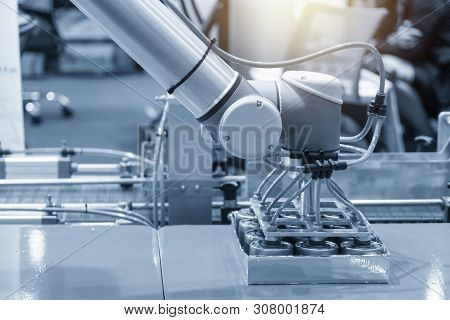 The Robotic Arm For Food Packing Process In Factory. The Industry 4.0 Concept By Robotic In Food Fac