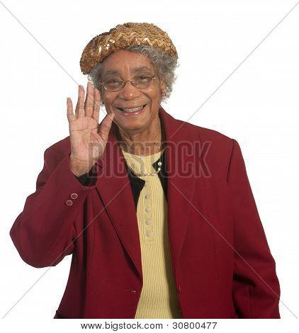 Happy senior woman waving