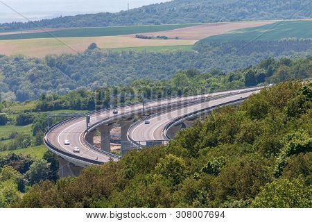 Large Concrete Overpass With Some Cars On It. Summer Landscape With Transport Flyover, Agricultural