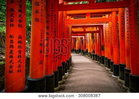 Kyoto, Japan - November 21, 2018: Walkway Covered By Red Gate With Japanese Language In Fushimi Inar