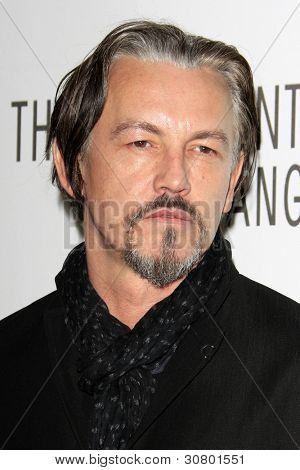 LOS ANGELES - MAR 7:  Tommy Flanagan arrives at the