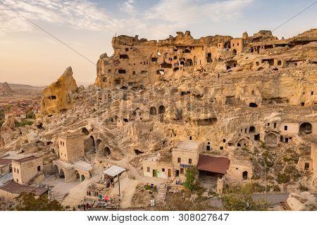 Sunset view of the Cavusin fortress and church Vaftizci Yahya, Saint John the Baptist in Cappadocia, Turkey