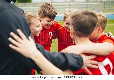 Happy Children Making Sport. Group Of Happy Boys Making Sports Huddle. Smiling Kids Standing Togethe