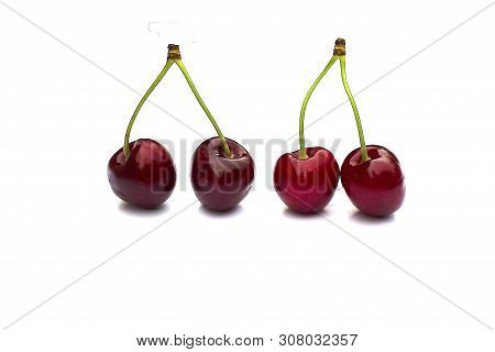 Cherry Isolated On White With Clipping Path. Four Cherries With Stems. Ripe Cherry Isolated. Sherry