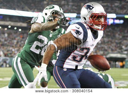 EAST RUTHERFORD, NJ - NOV 22: New England Patriots running back Shane Vereen (34) is tackled by New York Jets cornerback Kyle Wilson (20) at MetLife Stadium on November 22, 2012.