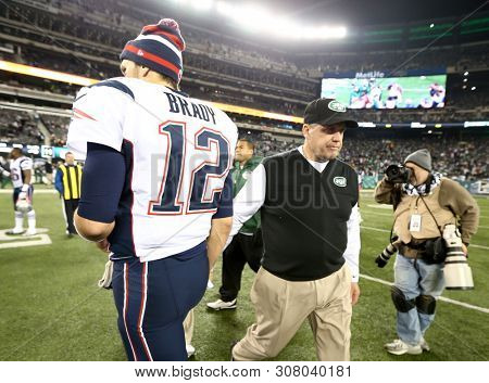 EAST RUTHERFORD, NJ - NOV 22: New York Jets head coach Rex Ryan and New England Patriots quarterback Tom Brady (12) shake hands after the game at MetLife Stadium on November 22, 2012.