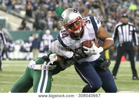EAST RUTHERFORD, NJ - NOV 22: New England Patriots running back Shane Vereen (34) is tackled by New York Jets defensive back Josh Bush (32) at MetLife Stadium on November 22, 2012.