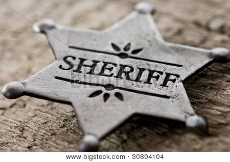 sheriff star isolated on black