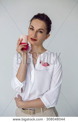 Young Attractive Beautician Aesthetician Woman In White Shirt