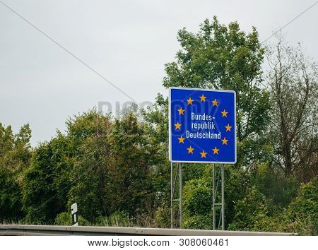 Entrance Street Highway Sign To Germany, Member Of European Union With Text Bundesrepublik Deutschla