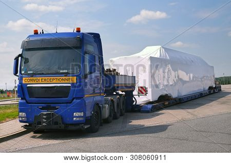 A Truck With A Special Semi-trailer For Transporting Oversized Loads. Oversize Load, Long Load Or Co