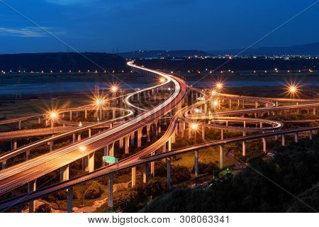 Aerial View Of Cars Driving On Complex Highway Or Freeway. Bridge Roads Or Streets In Structure Of A