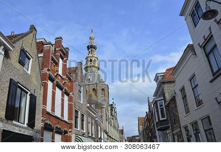 View Of A Street In The Old Town Zierikzee On Zeeland / Netherlands With The Stadhuis Museum With Bl