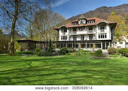 Beautiful House On The Background Of The Alps On A Sunny Spring Day. Weesen, Switzerland.