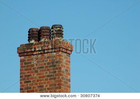 Old brick three pot chimney