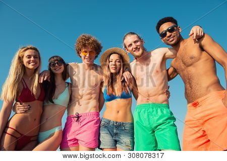 Group Of Friends Having Fun On The Beach. Concept Of Summertime