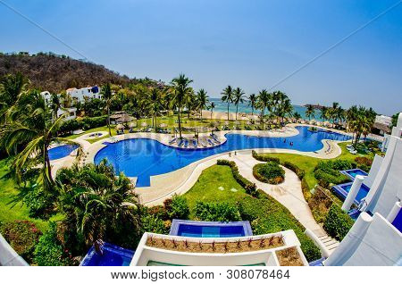 Huatulco, Mexico - April 14, 2012. View Of Balcony On Swimming Pool And Beach Of Pacific Ocean