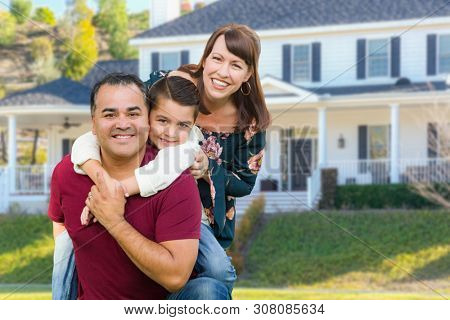 Happy Mixed Race Family Portrait In Front of Their House.