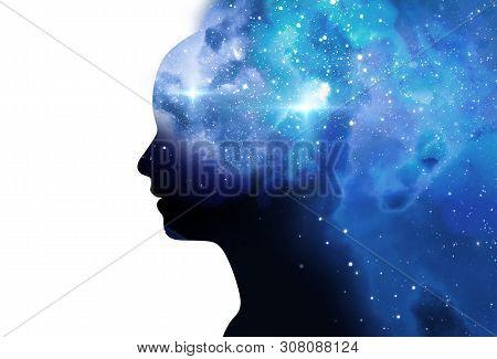 Silhouette Of Virtual Human With Aura Chakras On Space Nebula , Represent Meditation,yoga  And Deep