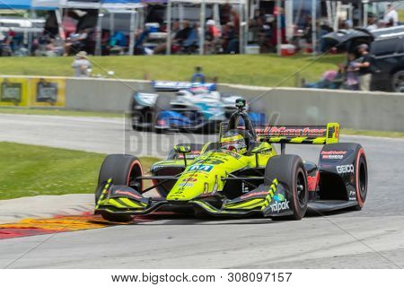 June 23, 2019 - Elkhart Lake, Wisconsin, USA: SEBASTIEN BOURDAIS (18) of France races through the turns during the  race for the REV Group Grand Prix at Road America in Elkhart Lake, Wisconsin.