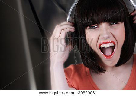 brunette wearing headset shouting