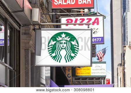 New York, Usa - 16 May, 2019: Starbucks Sign In A Starbucks Restaurant In New York. Starbucks Corpor