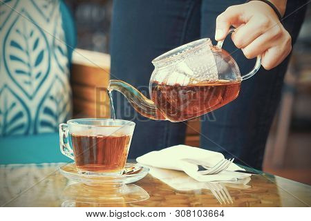 The Waitress Gives Tea To The Client. The Concept Of Service.