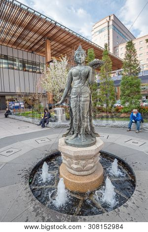 Nagano , Japan -april 19 ,2019 : View Of Buddhist Statue Outside Nagano Station (nagano-eki), A Rail