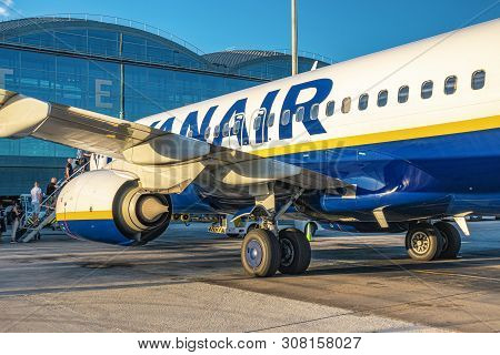 Alicante, Spain - June 18, 2019: People Boarding On Ryanair Jet Airplane In Alicante Airport. Ryanai