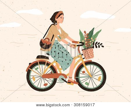 Funny Smiling Girl Dressed In Stylish Clothes Riding Bicycle With Flower Bouquet In Front Basket. Cu