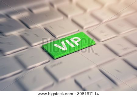 Close-up View On Gray Conceptual Keyboard - Vip Green Key. Blurred In Motion Background.