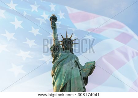 Double Exposure With Usa American Flag Waving And Statue Of Liberty For Memorial Day Or Independence