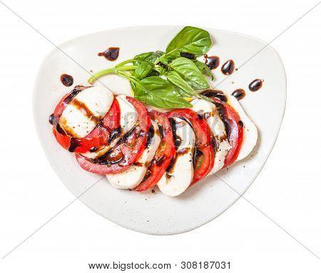 Italian Cuisine Insalata Caprese (caprese Salad) - Top View Of Sliced Mozzarella Cheese And Tomato W