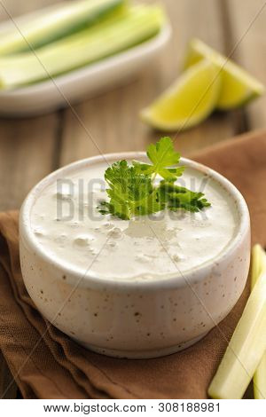 Blue Cheese Sauce In A Portion With Fresh Vegetables And Lime And Green Parsley. Wooden Background A