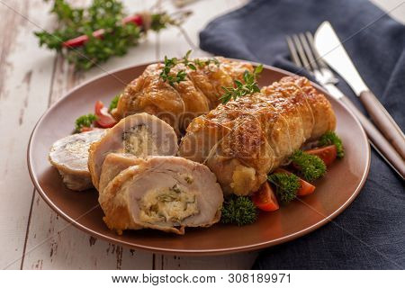 Stuffed Chicken Roll S Vegetable Garnish And Herbs. Pieces Of Roll Cut Off And Lie Next To A Large P