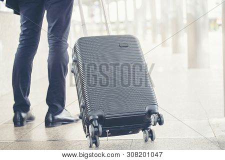 Business Man Dragging Suitcase Luggage Bag,walking To Passenger Boarding In Airport.working Young Ma