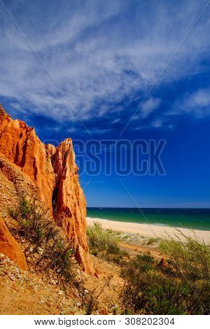 View on the beach Praia da Rocha Baixinha Nascente with beautiful red sandstone cliffs and golden sand. Region Faro, Algarve. Vacation in Portugal. poster