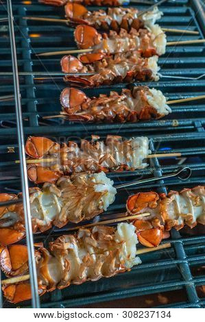 Lobster Tails Grilled For Dinner On Grill