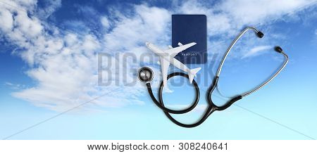 International Medical Travel Insurance Concept, Stethoscope, Passport And Airplane On Blue Sky Backg