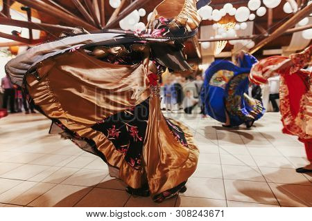 Beautiful Gypsy Girls Dancing In Traditional Gold Floral Dress At Wedding Reception In Restaurant. W